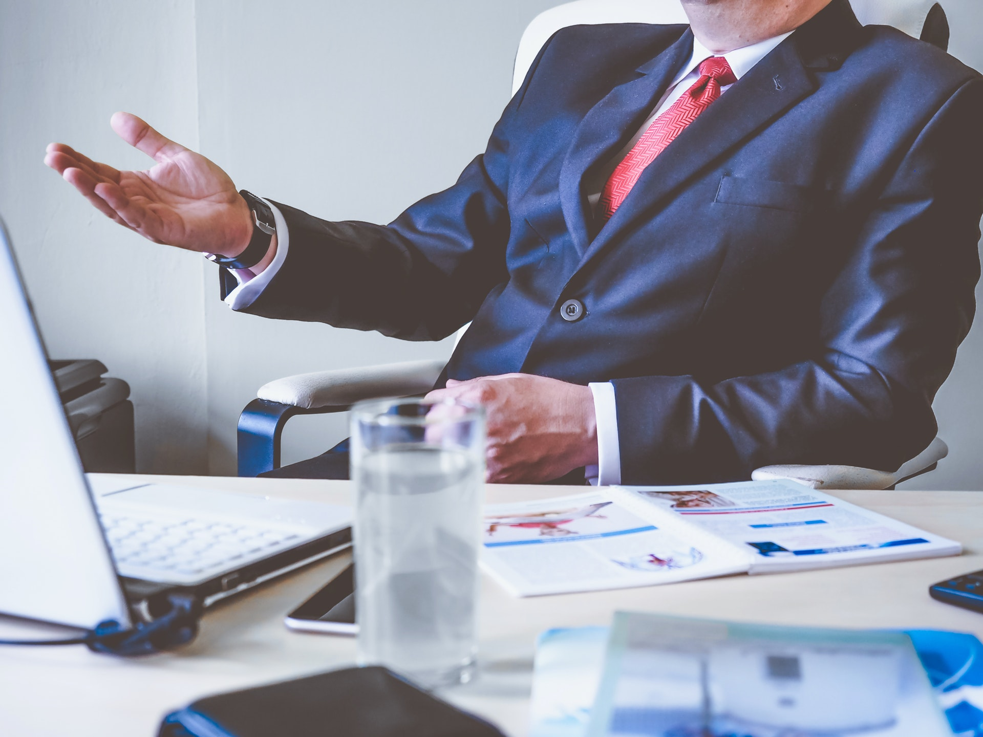 business vip or lead sitting at desk in business suit